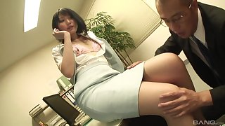 Secretary drops on her knees to suck a gumshoe and gets fucked from behind