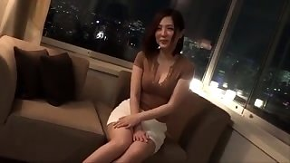 Cute Japanese chick in shiny lingerie loves toys