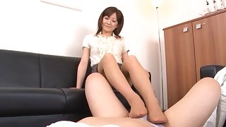 Asian chick gives a footjob together with drops on her knees to dynamite
