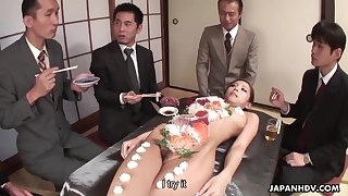 Sweltering businessmen are eating food off a hot babe's naked body