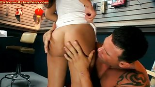 Asian bitch fucked in a sex shop by big muscular guy